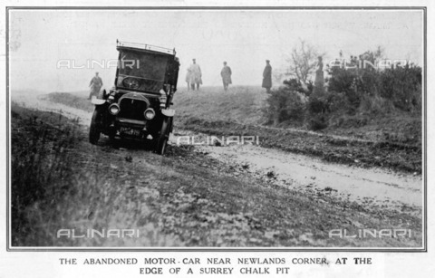 Photograph showing the abandoned motorcar at the edge of a Surrey chalk pit, near Newlands Corner.